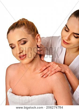 Shoulder and neck massage for woman in spa salon. Doctor making neck therapy in rehabilitation center on isolated. Correction of cervical vertebra.