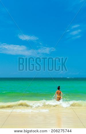 Woman walking on the tropical beach