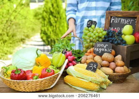 Woman selling fresh fruits and vegetables at farmer's market