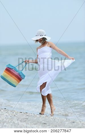 young happy woman on the beach in summer