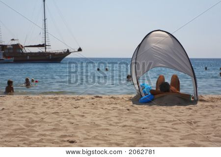 Man Chilling In The Sun With Ocean Background
