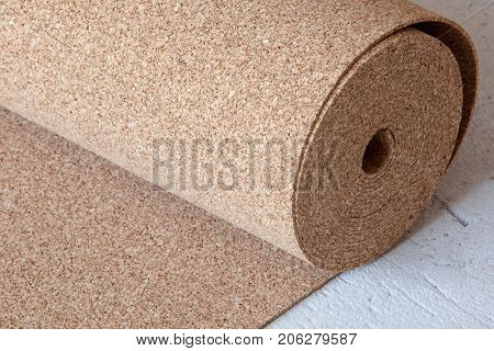 Natural Cork roll on the floor, a Substrate for a Laminate