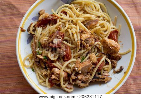 spaghetti with swordfish chunk and cherry tomatoes