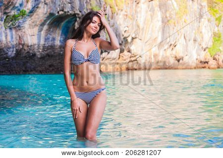 Beautiful woman in bikini on beach at Maya bay, Thailand