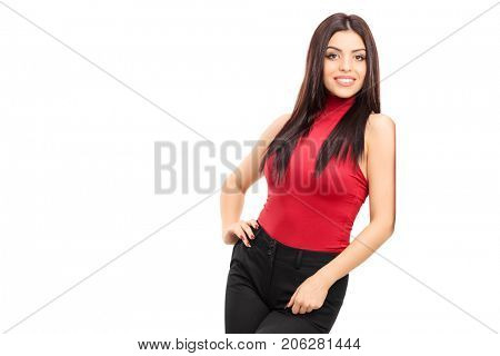 Fashionable girl leaning against a wall and smiling isolated on white background