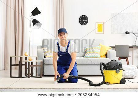 Man using steam vapor cleaner in living room
