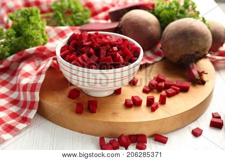 Bowl with sliced beetroot on table