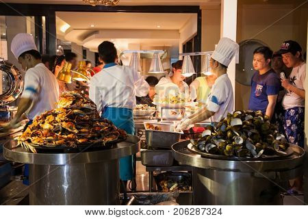 BORACAY, PHILIPHINES-MARCH 17, 2017:Group of chef preparing food in the kitchen of a public restaurant on March 17, 2017. Boracay, Philiphines.
