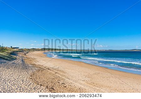 Beautiful Tropical Beach With Sand And Soft Waves