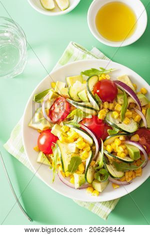 spiralized courgette salad with sweetcorn tomato avocado, healthy vegan meal