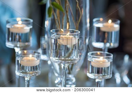 candles floating in stemware for wedding table decoration