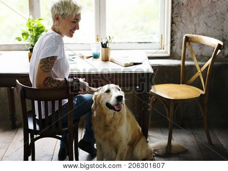 Golden Retriever Dog Sitting on The Wooden Floor with Owner