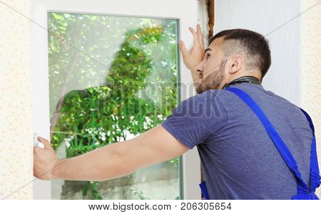 Worker repairing window in flat