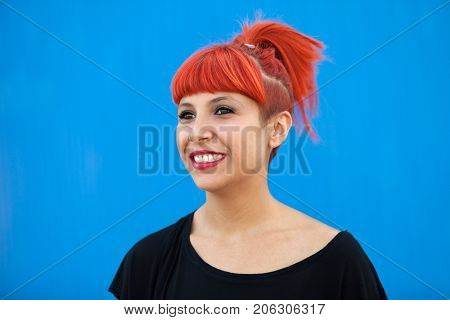 Red haired woman with black t-shirt on a blue background