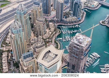 Dubai Marina Canal among hotels in Dubai Marina area and highway in Dubai, UAE