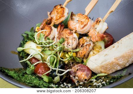 Fried shrimp-delicious fried shrimp with lettuce and rice in white plate