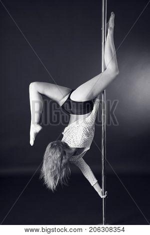 Beautiful blonde dancing on a pole