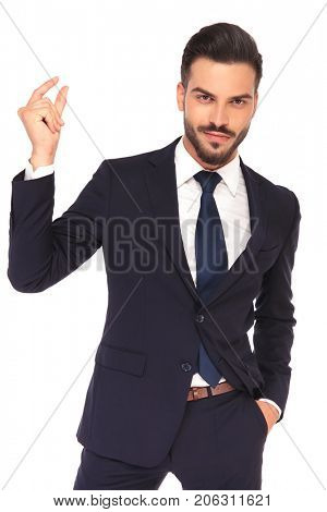 smiling  young business man snapping his fingers on white background
