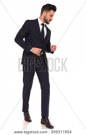 side view of a business man walking and looking down to something on white background