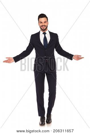 happy smiling young business man welcoming you on white background, full body picture