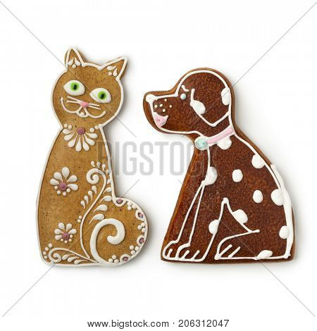 Cat and dog ginger cookies on white background