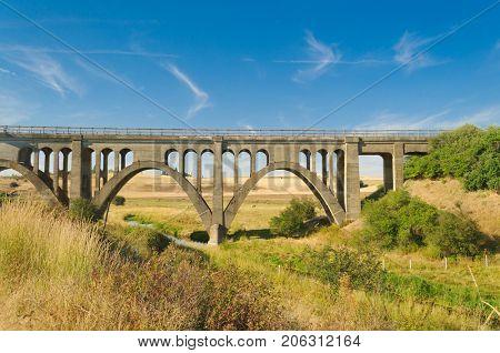 Old concrete trestle style bridge in the Palouse area of Washington
