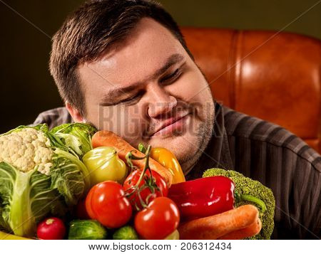 Diet fat man eating healthy food with vegetables cauliflower and sweet pepper with radish , tomatoes for overweight male. Male trying to lose weight first time. Treatment of constipation.