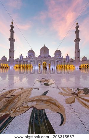 ABU DHABI, UAE - JAN 18, 2017: Evening Sheikh Zayed Mosque is one of six largest mosques in world, mosque was officially opened in 2007