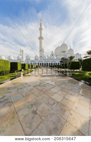 ABU DHABI, UAE - JAN 18, 2017: Garden and Sheikh Zayed Mosque is one of six largest mosques in world, mosque was officially opened in 2007