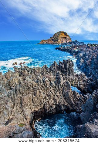 Rocks, coves and grottoes off the Atlantic coast of Madeira.  Paradise Island in the Atlantic Ocean. The concept of exotic and ecological tourism