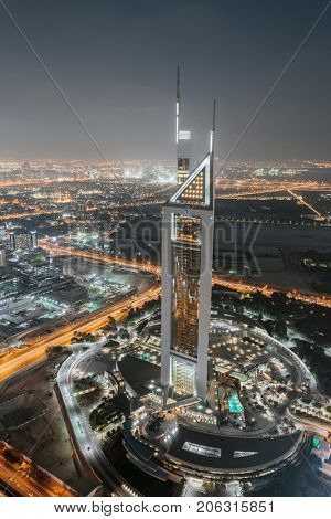 DUBAI, UAE - JAN 8, 2017: Jumeirah Emirates Towers Hotel at night, At structural height of 309 m