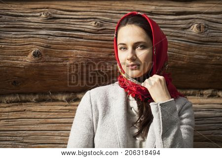 Russian girl. Portrait of beautiful young brunette woman in red russian neckerchief