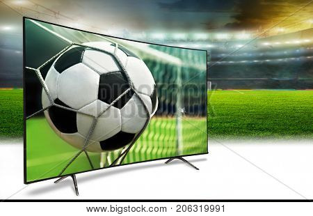 Football stadium in the evening with a TV screen and ball with the stars