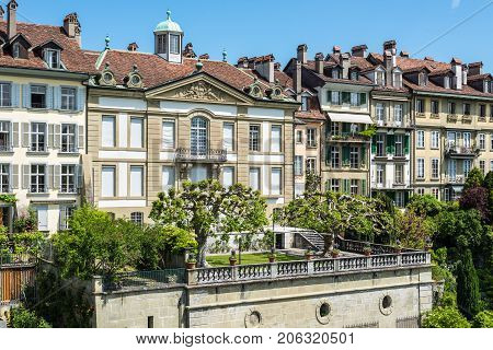 Bern Switzerland - May 26 2016: Upscale residential area with gardens near the Bern Cathedral and Aare River.