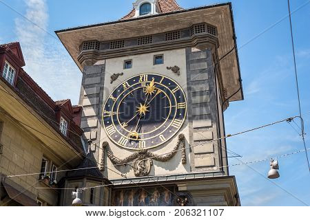 Bern Switzerland - May 26 2016: The Zytglogge old clock tower in Bern Switzerland. Built in the early 13th century it has served the city as guard tower prison clock tower centre of urban life and civic memorial.