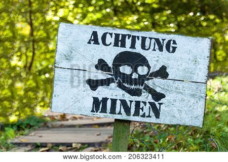 Warning of mines. Danger of explosion. Line of defense. Military base. German inscription: