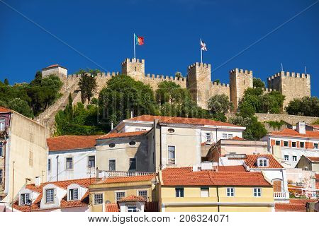 Saint George Castle Surrounded By Residential Houses Of Alfama. Lisbon. Portugal