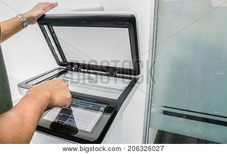 selective focus businessman use touch screen of multi function of office printer