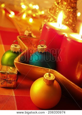 Colorful Christmas background with decoration selective focus on a golden gift box and the blue Christmas bauble