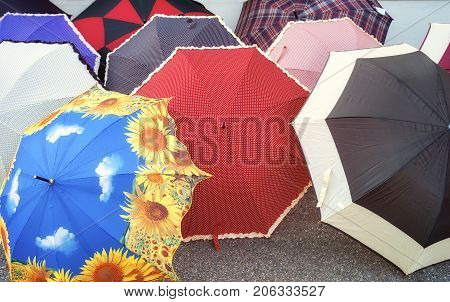 Coloured open umbrellas, exposed for selling in a country fair (Northern Italy). Color image.