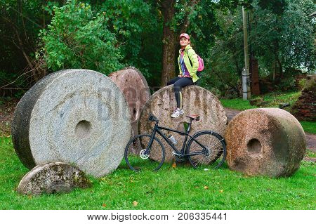 old millstones round attraction in the village