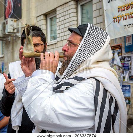 Uman Ukraine - 21 September 2017: Rosh Hashanah Jewish New Year 5778. It is celebrated near the grave of Rabbi Nachman in Uman. Jewish hasid blows Shofar.