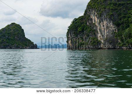 Narrow Passage Among Mountain Islands In Halong Bay