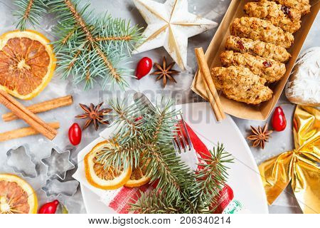 Christmas decoration homemade cookies and New Year symbols. Top view concrete rustic background.