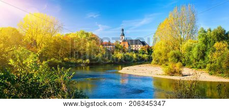 Panorama of an idyllic place at Neckar River Germany on a nice autumn day with the small church of the residing town