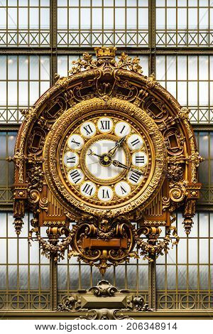 Paris France - July 05 2017: Golden clock in the Orsay Museum. The Musee d'Orsay is a museum in Paris on the left bank of the river Seine. Musee d'Orsay has the largest collection of impressionist and post-impressionist paintings in the world.