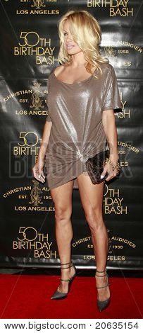 LOS ANGELES - MAY 23:  Pamela Anderson arrives at Christian Audigier's 50th birthday party on May 23, 2008 in Los Angeles, California.