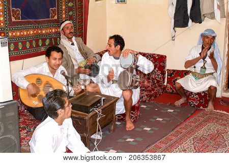 People Playing Traditional Music At Manakhah On Yemen
