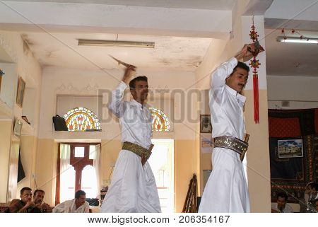 Manakhah Yemen - 7 January 2008: two men dancing the traditional yemeni dance with jambiya dagger