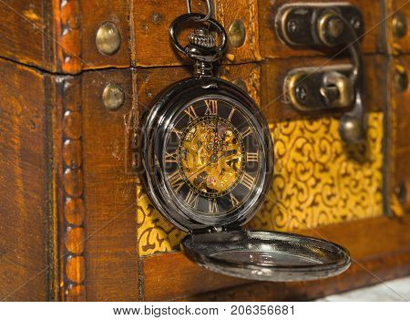 Vintage Pocket Watch Against The Background Of Old Trunk